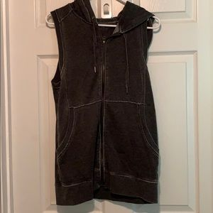 Hooded dark gray zippered vest.